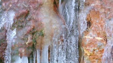 Icicles in  small wellspring. — Stock Video