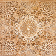 Arabic pattern texture at Alhambra palace in Granada, Spain — Stock Photo #18732477
