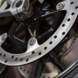 Closeup photo of motorcycle wheel brake — Stock Photo