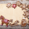 Gingerbread cookies lies over wooden backgroun — Lizenzfreies Foto