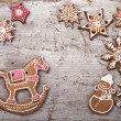 Stock Photo: Gingerbread cookies lies over wooden backgroun