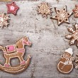 Gingerbread cookies lies over wooden backgroun — Stock Photo
