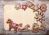 Gingerbread cookies lies over wooden backgroun — Photo