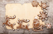 Gingerbread cookies lies over wooden backgroun — 图库照片