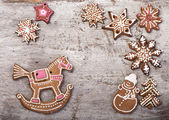 Gingerbread cookies lies over wooden backgroun — Stok fotoğraf
