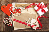 Vintage card with red heart on grunge old background,valentin es day background — Stok fotoğraf