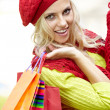Smiling girl in autumn colours with shopping bags - Foto de Stock