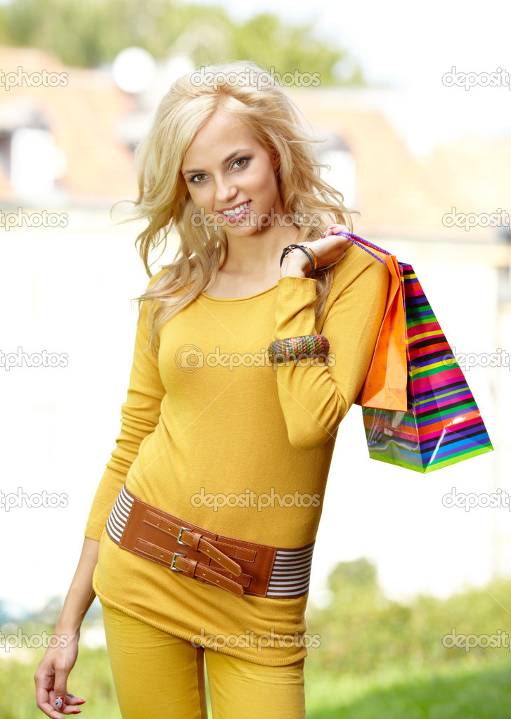 Smiling girl with shopping bags   Stock Photo #12581011