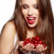 Happy woman with cherries over white - ストック写真