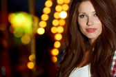 Portrait of beautiful petite woman in night city. Shallow DOF. — Stock Photo