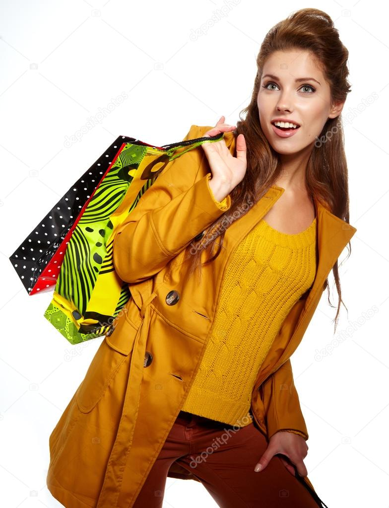 Young woman with shopping bags over white background   Stock Photo #12631757