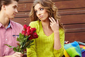 Close up portrait of attractive young couple in autumn color. — Stock Photo