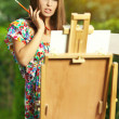 Woman artist paints nature — Stock Photo