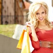 Happy young woman shopping - 图库照片