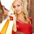 Happy young woman shopping — Stock Photo #13218912