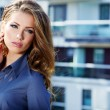 Portrait of pretty young business woman smiling — Stock Photo #13220271