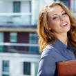 Royalty-Free Stock Photo: Beautiful business woman on the background of the modern office