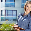 Beautiful business woman on the background of the modern office — Stock Photo