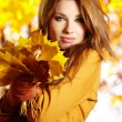 Autumn woman on leafs background — Stock Photo #13253360