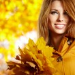 Autumn woman on leafs background — Stock Photo #13253430