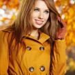 Autumn woman on leafs background — Stock Photo #13253583