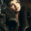 Fashion portrait of young pretty woman with fur — Stock Photo #13253945