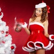 Royalty-Free Stock Photo: Portrait of beautiful sexy girl wearing santa claus clothes on r