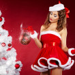 Portrait of beautiful sexy girl wearing santa claus clothes on r - Stock Photo