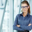 Business woman holding glasses and looking at camera. Copy space — Stock Photo