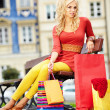 Beautiful shopping woman at a old city — Stock Photo