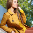 Young brunette woman portrait in autumn color — Stock Photo #13860776