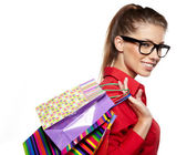 Shopping woman holding bags, isolated on white studio background — Stock Photo