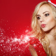 Photo of fashion Christmas girl blowing snow. — Stock Photo #13899521