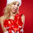 Winter portrait of a santa woman with a christmas gift — Stock Photo