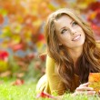 图库照片: Beautiful girl with book in the autumn park