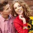 Close up portrait of attractive young couple in love outdoors. — Stock Photo