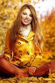Autumn woman on leafs background — Stock Photo