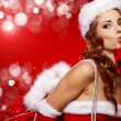 Beautiful and sexy woman wearing santa clause costume — Stock Photo #14078203