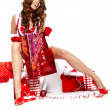 Beautiful sexy girl wearing santa claus clothes with christmas g — Foto Stock
