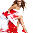 Beautiful sexy girl wearing santa claus clothes with christmas g — Stock Photo #14080316