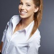 Portrait of young smiling businesswoman — Stock Photo #14369557