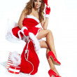 Beautiful sexy girl wearing santa claus clothes — Stock Photo #14450521