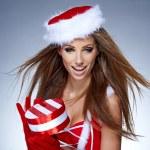 Santa girl on snow blue background — Stock Photo #14451615