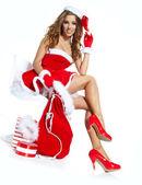 Krásná sexy dívka, která nosí santa claus oblečení — Stock fotografie