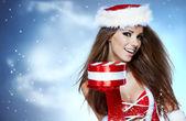 Santa girl on snow blue background — Stock Photo