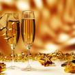 Glasses of champagne on yellow background — Stock Photo