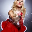 Winter portrait of a santa woman with a christmas gift — Stock Photo #14756223