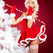 Beautiful blonde woman in Santa costume — Stock Photo