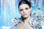 Young woman in creative image with silver artistic make-up. — Stock Photo