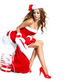 Beautiful sexy girl wearing santa claus clothes with christmas g — Stock Photo